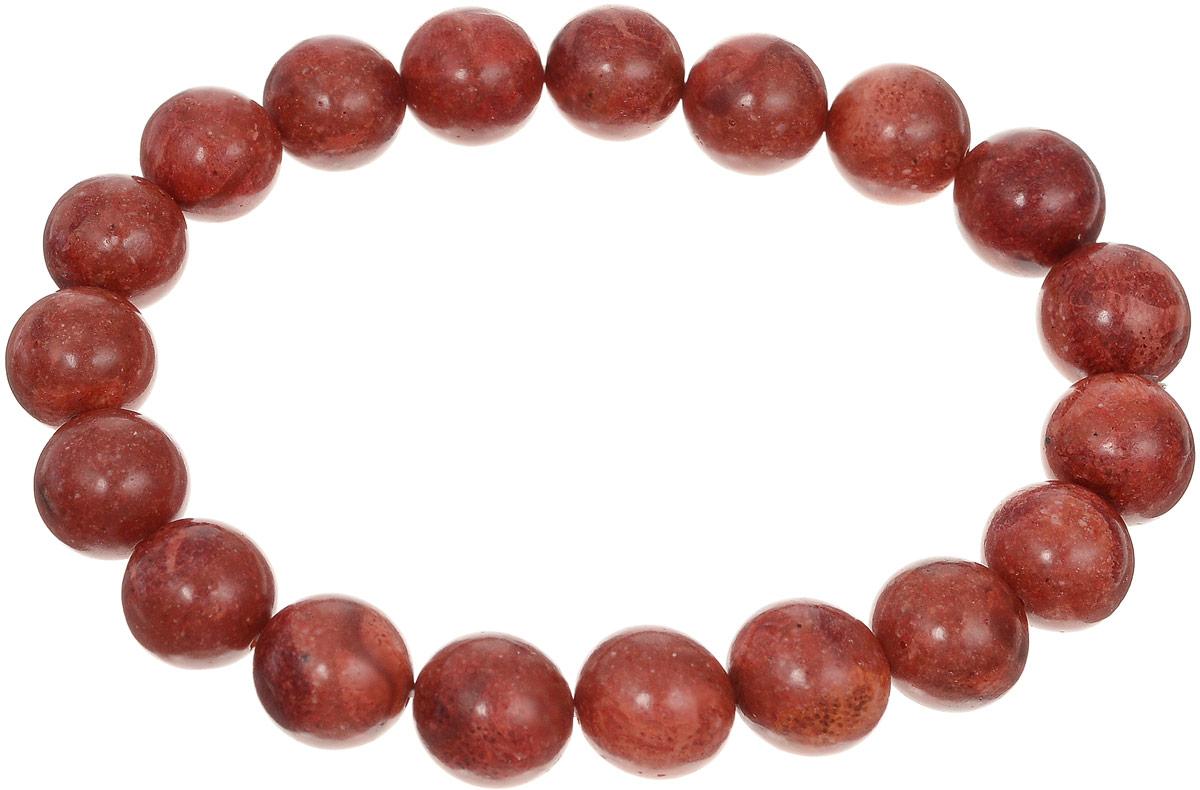 Браслет Art-Silver, цвет: красно-коричневый. КОРк10-123КОРк10-123Браслет Art-Silver изготовлен из коралла. Изделие оформлено однотонными бусинами и оснащено эластичной резинкой для удобства надевания.