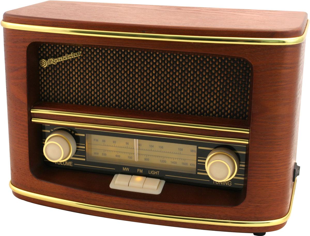 RoadStar HRA-1500N ретро-радиоHRA-1500NОригинальный радио проигрыватель RoadStar HRA-1500N станет актуальным подарком для меломана или просто любителя ретро-дизайна. Изготовлен из дерева с золотыми окантовками, а динамик скрывает твидовая ткань. Такое исполнение подчеркивает классический стиль радио 60 годов.