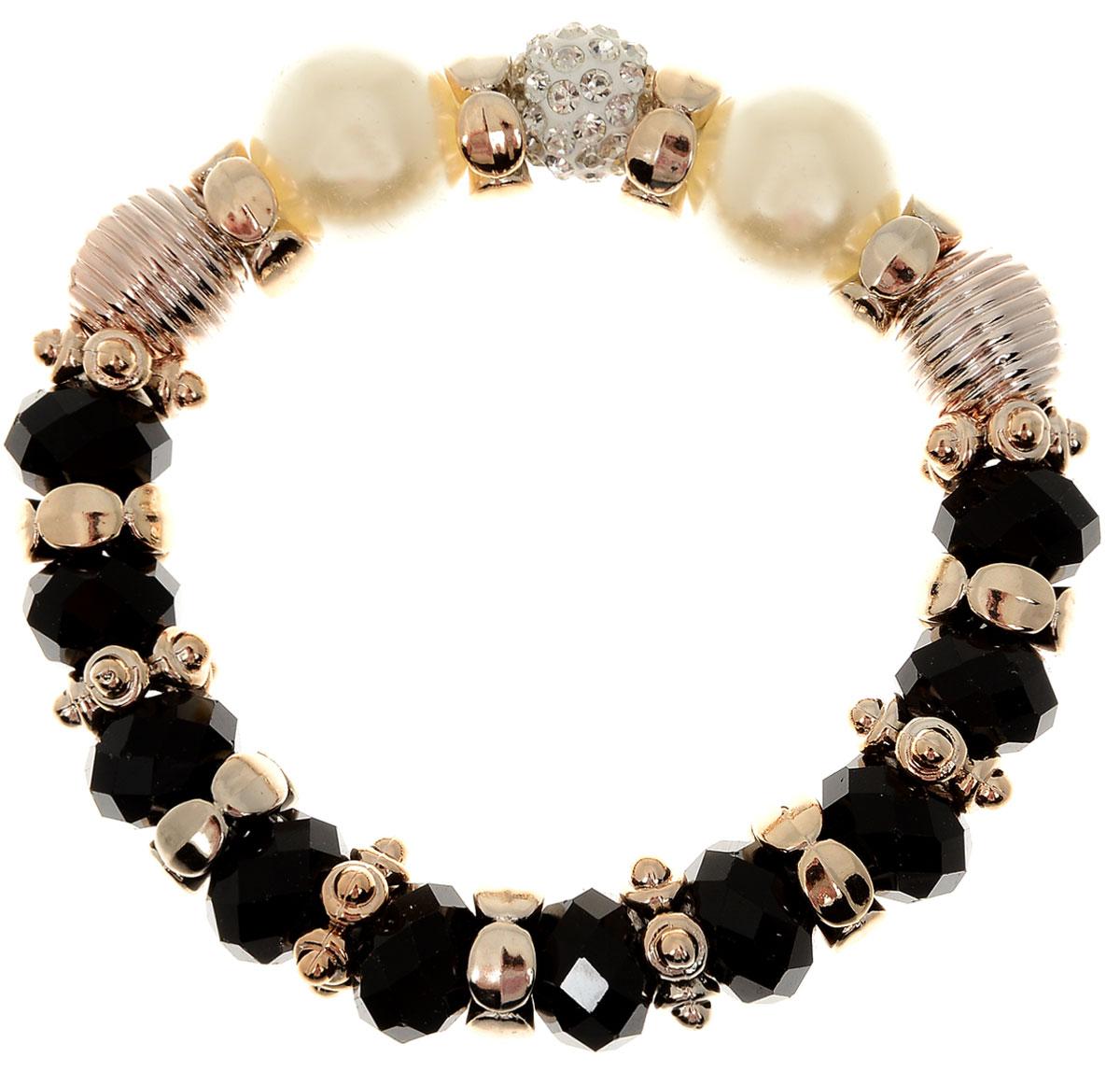 Браслет Taya, цвет: черный. T-B-11915-BRAC-BLACKT-B-11915-BRAC-BLACKУдобный, современный браслет на резинке. Половина его из кристаллов и золотых перемычек, другая - из жемчужин. Можно переворачивать и носить той стороной, которая сегодня подходит под одежду.