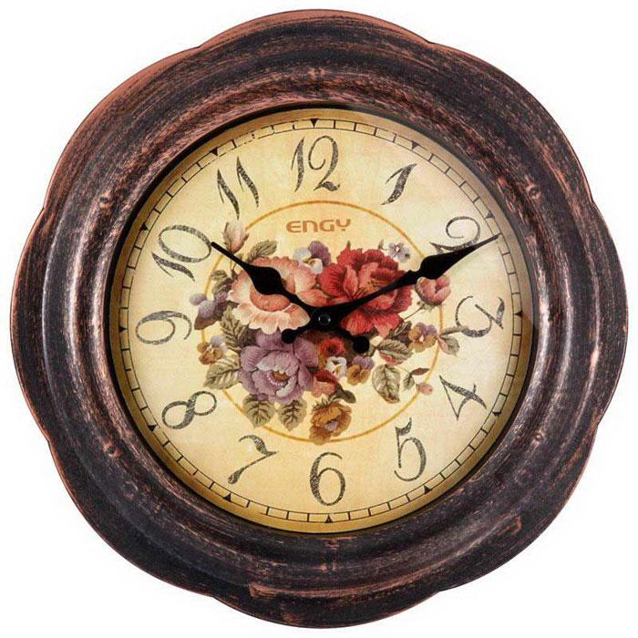 Engy ЕС-18, Brown Black настенные часы54 009318Настенные кварцевые часы с плавным ходом Energy ЕС-12 имеют оригинальный дизайн под старину и поэтому подойдут для вашего дома или офиса, декорированного в подобном стиле. Крупные цифры черного цвета на светло-коричневом фоне отлично различимы даже в условиях плохого освещения. Питание осуществляется от 1 батарейки типа АА (в комплект не входят).