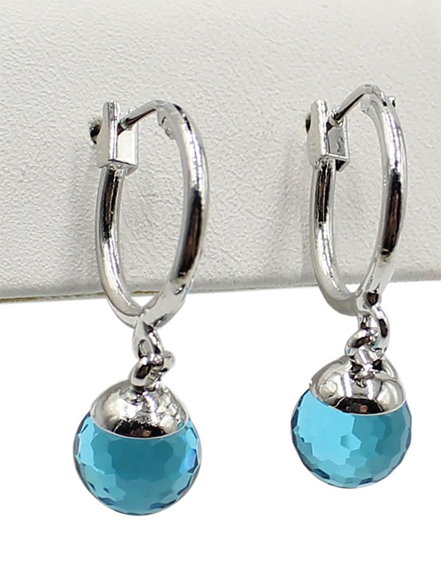 Серьги Taya, цвет: серебристый, синий. T-B-12383T-B-12383-EARR-SL.BLUEСерьги с итальянской застежкой изготовлены из бижутерного сплава. Классические серьги- кольца с подвеской. Подвеска оформлена в виде сияющего кристалла.
