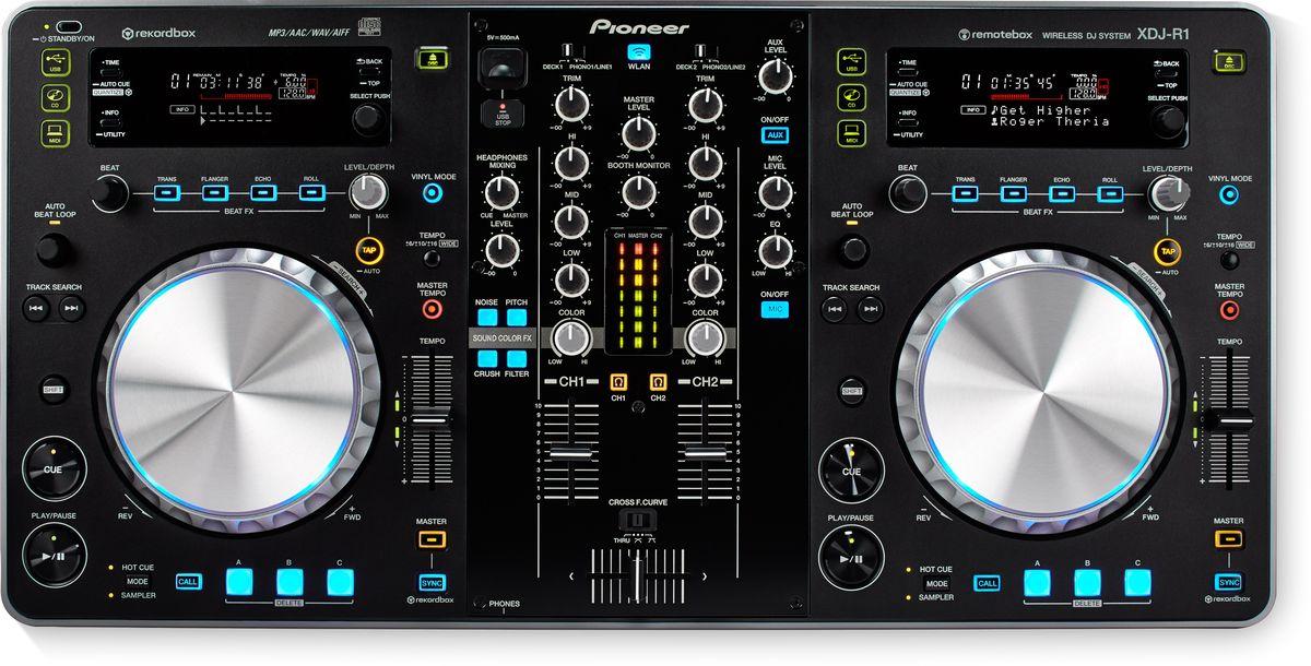 Pioneer XDJ-R1 DJ контроллер344942Pioneer XDJ-R1 - DJ контроллер с возможностью беспроводного управления. Это комбинированная конструкция из двух плееров и микшера c внушительными характеристиками. XDJ-R1 можно управлять с помощью беспроводных технологий с iPad, iPhone или iPod Touch, подключившись к собственной беспроводной локальной сети XDJ-R1. Просматривайте с сенсорного экрана музыку, создавайте миксы, делайте поппури из треков — для этого не обязательно находиться в непосредственной близи с контроллером. Все необходимые для диджея возможности собраны в одном портативном устройстве. Pioneer XDJ-R1 воспроизводит музыку с самых разных источников, таких как CD, USB, PC, Mac и iOS-устройства. Вы можете просматривать свое rekordbox устройство,загружать музыку, управлять эффектами, параметрами, деками, делать лупы и пользоваться CUE-метками — достаточно установить приложение remotebox. На каждом канале присутствует Sound Color Filter, что позволяет выполнять...