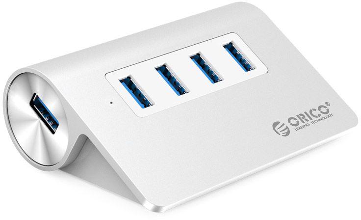 Orico M3H4 USB-концентраторM3H4Orico M3H4-SV 4-Ports - это и есть тот самый разветвитель, позволяющий физически расширить количество разъёмов на вашем компьютере. Данная модель поддерживает 4 высокоскоростных разъёма USB 3.0, позволяющих передавать и считывать информацию со скоростью до 5 гигабит в секунду. Так же хаб обратно совместим с USB 2.0 и 1.1, что позволяет последним работать на пределе своих возможностей. Рассматриваемый девайс потребляет незначительное количество энергоресурсов, при этом каждый из портов обеспечивается стабильным питанием. В процессе работы устройство не перегревается и защищает USB-устройства от скачков в электросети. Высокопрочные АБС-пластик и алюминий, из которых выполнен девайс делает его долговечным в использовании.