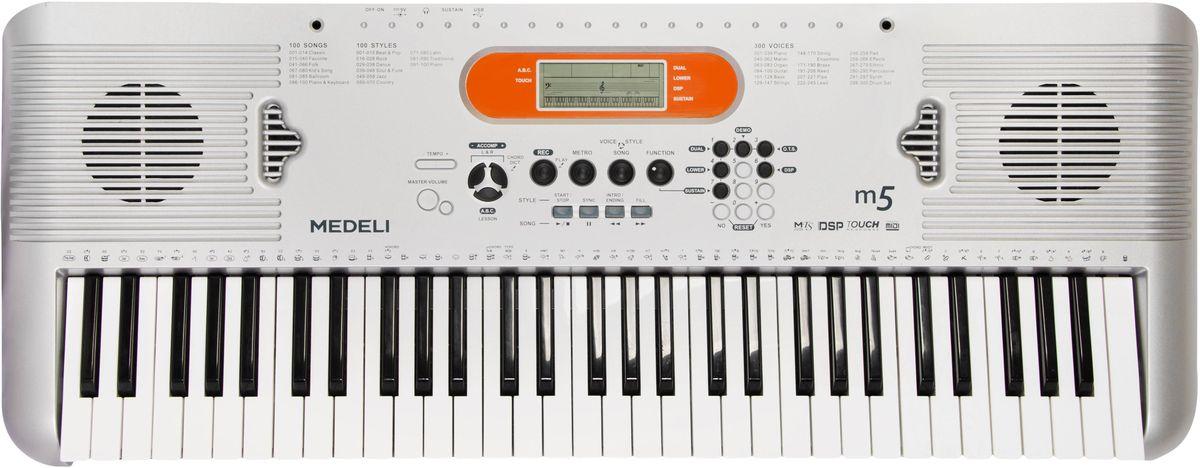 Medeli M5 цифровой синтезаторM5Количество клавиш: 61 Чувствительность к касанию: есть Полифония: 32 Количество голосов: 300 Количество стилей: 100 Функция обучения: есть Функция записи: есть Метроном: есть Колесо Pitch Bend: нет Дисплей: ЖК-дисплей без подсветки Выход наушники: есть Вход для педали сустейн: есть USB-MIDI для подключения к компьютеру: есть Питание: DC 9V Работа от батареек: 6 элементов типа AA Мощность динамика: 2 х 3 Вт Блок питания: в комплекте