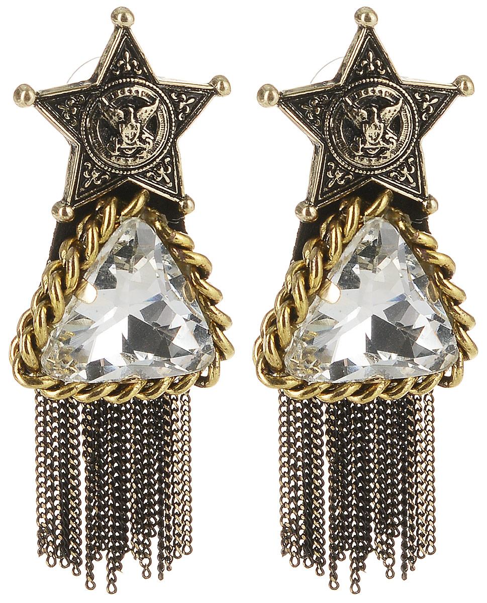 Серьги Taya, цвет: золотистый, белый. T-B-10090T-B-10090-EARR-GL.WHITEСерьги-гвоздики с силиконовой заглушкой. Украшение сделано в черненом золоте. Оно состоит из трех частей, которые плотно соединены между собой. Сверху расположена звезда с изображением орла, символа победы и величия, в центре - кристалл, обрамленный цепочкой, а низ дополнен стильными цепочками.