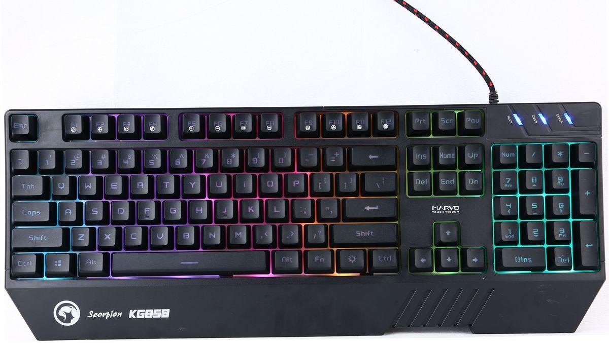 Marvo KG858, Black игровая клавиатураKG858Подсветка: RGB, 9 режимов Интерфейс: USB 2.0 Качество клавиш: 104 Мультимедиа: клавиши есть, через FN AntiGhosting Дренаж Отклик: 1 мс Кол-во одновременных нажатий: 19 KRO