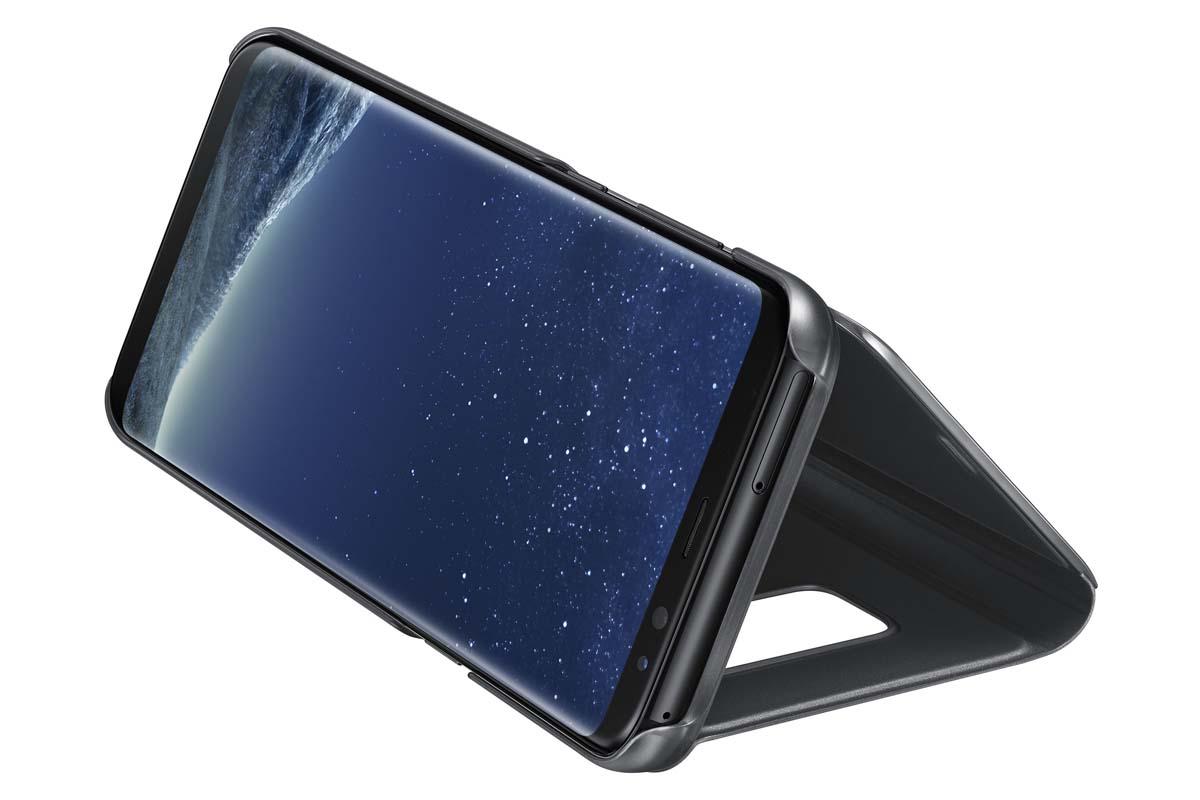 Samsung Clear View Standing чехол для Galaxy S8+, BlackEF-ZG955CBEGRUТонкий полупрозрачный чехол подчеркивает стиль и изящество смартфона. Аксессуар обеспечивает быстрый доступ к функциям — следите за информацией на экране, не открывая чехла. Сквозь прозрачную верхнюю крышку видны время, пропущенные вызовы, индикатор заряда. Флип-кейс отзывчиво реагирует на прикосновения — отвечайте на звонки одним легким движением. Чехол устойчив к появлению отпечатков пальцев — ваш смартфон всегда в аккуратном состоянии. Особое покрытие чехла защищает смартфон от повреждений, продлевая срок его службы.