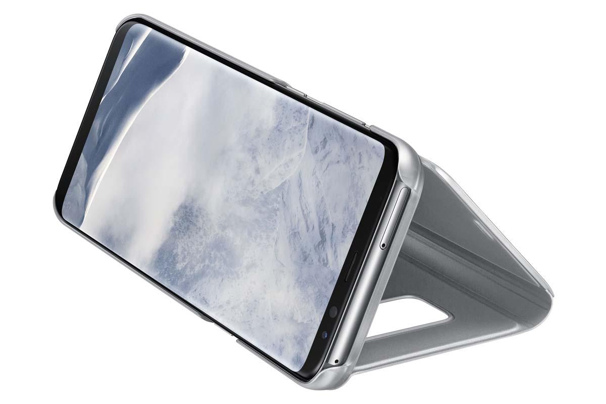 Samsung Clear View Standing чехол для Galaxy S8+, SilverEF-ZG955CSEGRUТонкий полупрозрачный чехол подчеркивает стиль и изящество смартфона. Аксессуар обеспечивает быстрый доступ к функциям — следите за информацией на экране, не открывая чехла. Сквозь прозрачную верхнюю крышку видны время, пропущенные вызовы, индикатор заряда. Флип-кейс отзывчиво реагирует на прикосновения — отвечайте на звонки одним легким движением. Чехол устойчив к появлению отпечатков пальцев — ваш смартфон всегда в аккуратном состоянии. Особое покрытие чехла защищает смартфон от повреждений, продлевая срок его службы.