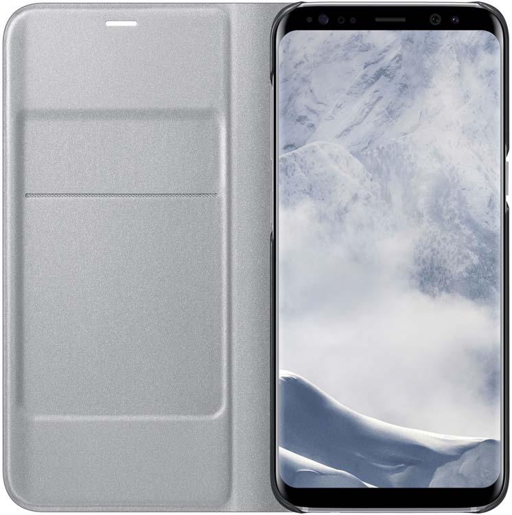 Samsung LED-View чехол для Galaxy S8, SilverEF-NG950PSEGRUЧехлы LED View Cover предназначены для флагмана от Samsung ? Galaxy S8. Верхняя крышка флип-кейса оснащена чувствительным сенсором, который реагирует на открытие/закрытие и нажатие кнопки питания. На передней панели чехла отображается текущая информация экрана – время, процент заряда, пропущенные вызовы и смс. Очередная фишка чехла – возможность отвечать на звонки, не открывая его, - просто проведите пальцем по панели, как по экрану. Чехол плотно прилегает к смартфону и предохраняет модель от падений и попадания пыли.