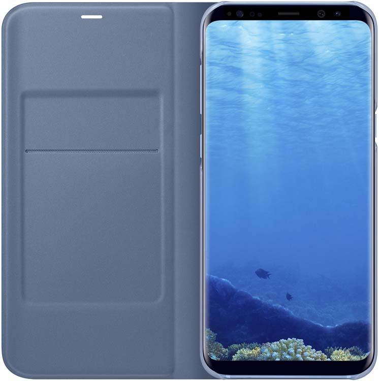 Samsung LED-View чехол для Galaxy S8+, BlueEF-NG955PLEGRUЧехлы LED View Cover предназначены для флагмана от Samsung ? Galaxy S8+. Верхняя крышка флип-кейса оснащена чувствительным сенсором, который реагирует на открытие/закрытие и нажатие кнопки питания. На передней панели чехла отображается текущая информация экрана – время, процент заряда, пропущенные вызовы и смс. Очередная фишка чехла – возможность отвечать на звонки, не открывая его, - просто проведите пальцем по панели, как по экрану. Чехол плотно прилегает к смартфону и предохраняет модель от падений и попадания пыли.