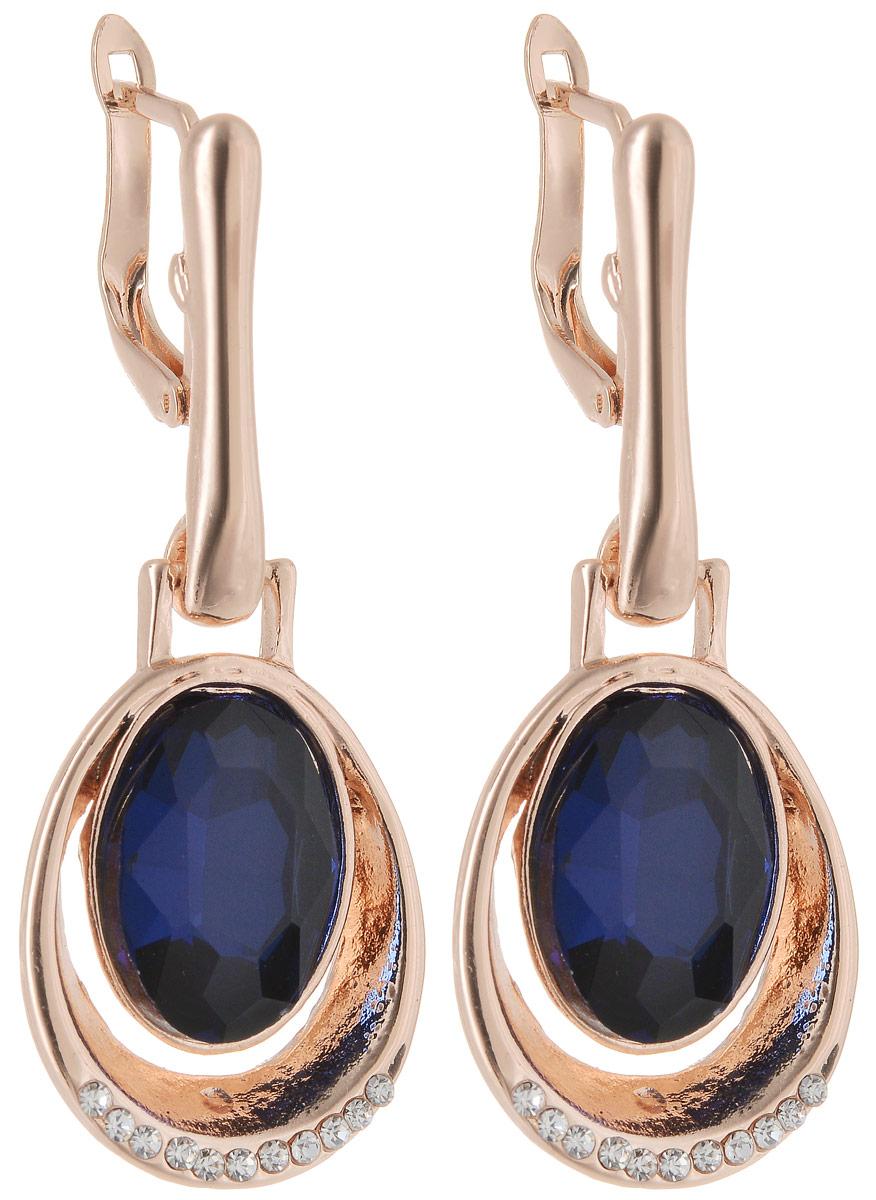 Серьги Taya, цвет: золотистый, темно-синий. T-B-12745T-B-12745-EARR-GL.D.BLUEСерьги Taya застегиваются на английский замок. Сверкающий кристалл обрамлен золоток каймой, нижняя часть которой покрыта стразами.