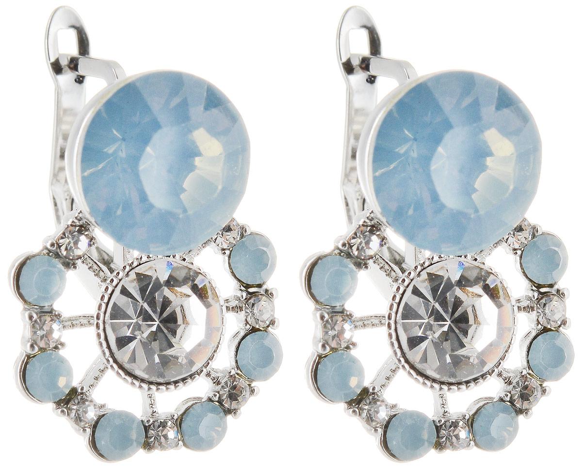 Серьги Taya, цвет: серебряный, голубой. T-B-12885T-B-12885-EARR-LT.BLUEСерьги-гвоздики с заглушкой металл-пластик. Украшение смотрится дорого за счет изящных форм и сочетания блеска. Вкрапления из страз и кристаллов переливаются на свету.