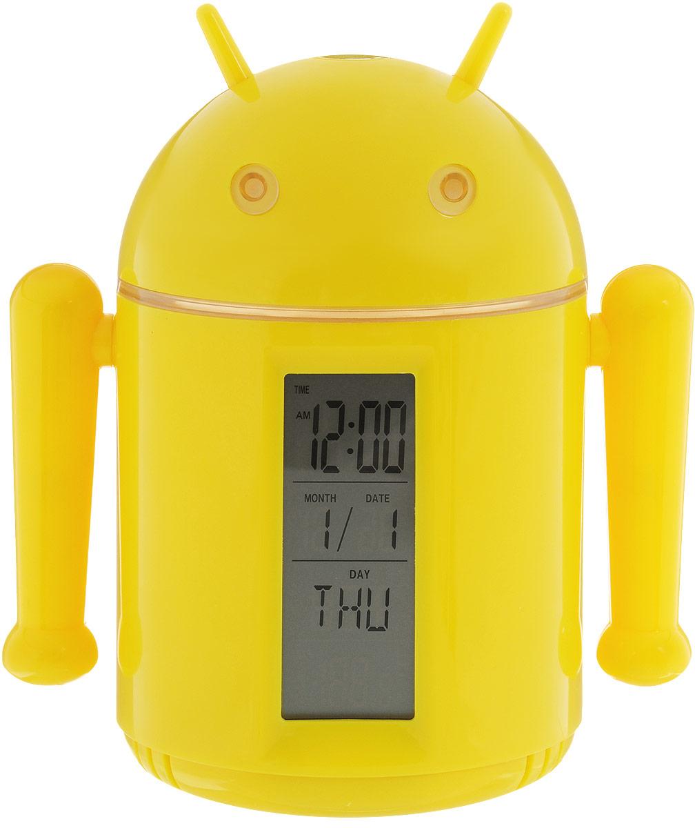 Sima-land Лампа настольная сенсорная Робот цвет желтый1193589_жёлтыйСегодня особо ценятся уникальные креативные предметы интерьера, и настольная сенсорная лампа Sima-land Робот как раз из их числа. Лампа выполнена из качественного пластика в виде забавного желтого робота с рожками. Голова робота поднимается над корпусом с помощью телескопических держателей и может поворачиваться под любым углом. На нижней поверхности головы робота расположены 20 ярких светодиодов, которые включаются с помощью кнопки на его макушке. Если провести пальцем или рукой между глаз робота, то они будут светиться. Руки робота подвижны. На лицевой стороне корпуса расположен жидкокристаллический дисплей, отображающий информацию о времени суток, дате и температуре окружающего воздуха. На нижней поверхности корпуса имеется кнопочная панель для настройки часов, будильника, календаря и переключения отображения температуры в градусах Цельсия или Фаренгейта. Оригинальную лампу можно установить на стол или любую ровную поверхность, можно подвесить с помощью ремешка (в...