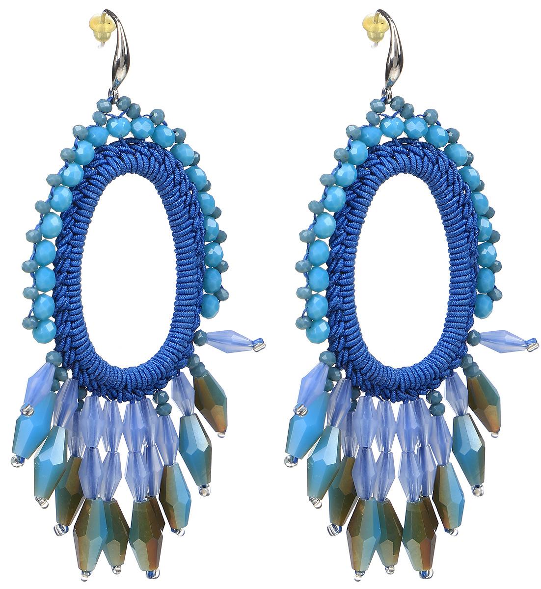 Серьги Taya, цвет: синий. T-B-9559-EARR-BLUET-B-9559-EARR-BLUEСерьги с замком-петлей и силиконовой заглушкой изготовлены из гипоаллергенного бижутерного сплава и текстиля. Серьги выполнены в форме овала с окантовкой из камней.