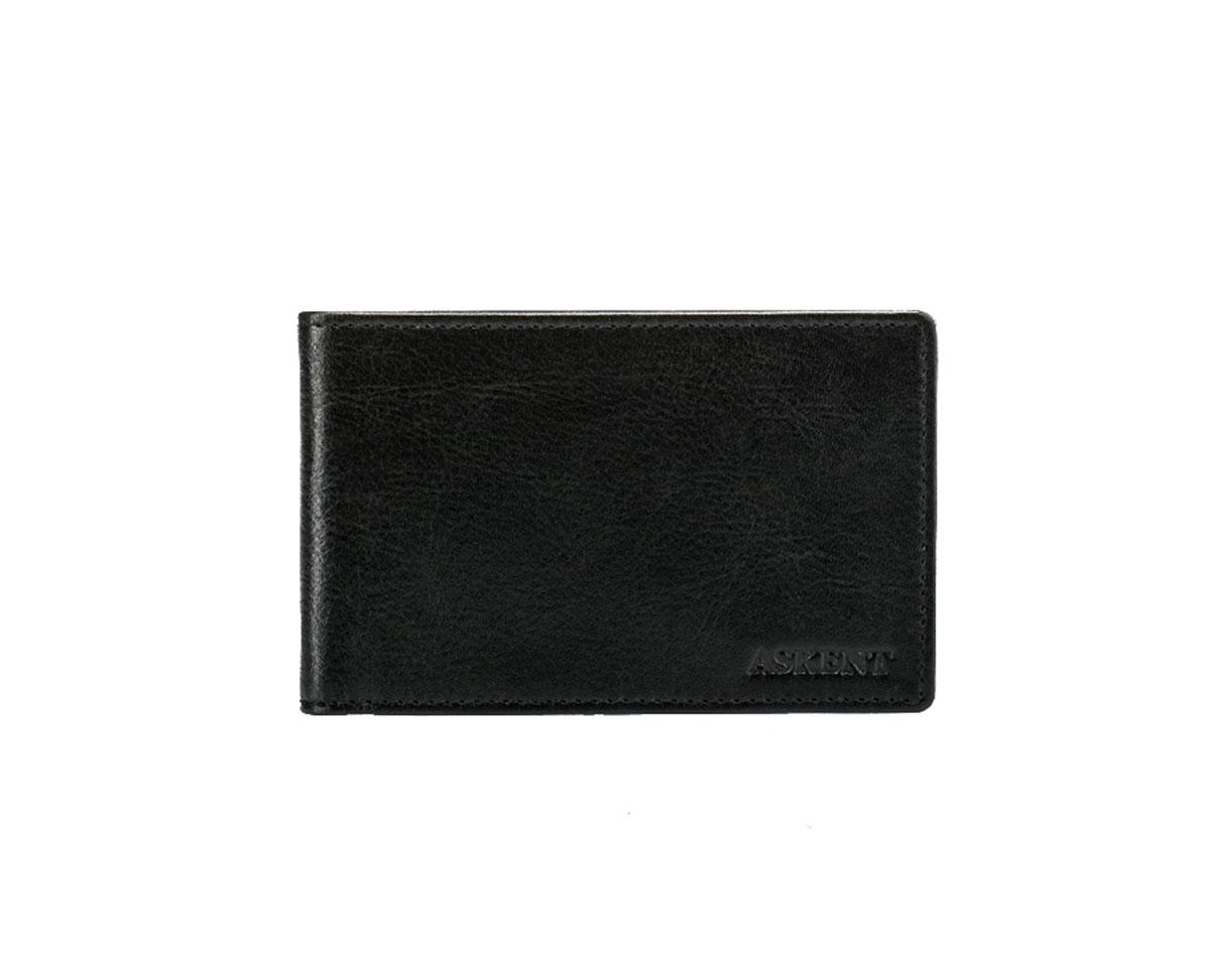 Визитница горизонтальная Askent, цвет: черный. V.1.MNA16-11154_711Модная горизонтальная визитница Askent изготовлена из натуральной кожи и исполнена в лаконичном стиле. Лицевая сторона оформлена тисненым названием бренда. Внутри содержится съемный блок из прозрачного мягкого пластика на 20 визиток, а также 2 удобных боковых кармана.Изделие упаковано в фирменную коробку.Стильная визитница подчеркнет вашу индивидуальность и отменный вкус, а также станет замечательным подарком человеку, ценящему качественные и практичные вещи.