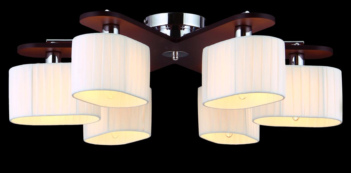 Люстра Natali Kovaltseva, 6 x E14, 60W. 10714/6CRAVENNA 11398/5C CHROMEЛюстра Natali Kovaltseva, выполненная в эко стиле, станет украшением вашей комнаты и оригинально дополнит интерьер. Изделие крепится к потолку. Такая люстра универсальна и отлично подойдет для освещения кабинета, столовой, кухни, спальни или гостиной. Люстра выполнена из металла с хромированным покрытием и индийского красного дерева тун. Изделие имеет 6 плафонов, выполненных из легкого текстиля в складку.В коллекциях Natali Kovaltseva представлены разные стили - от классики до хайтека. Дизайн и технологическая составляющая продукции разрабатывается в R&D центре компании, который находится в г. Дюссельдорф, Германия. При производстве продукции используются высококачественные и эксклюзивные материалы: хрусталь ASFOR, муранское стекло, перламутр, 24-каратное золото, бронза. Производство светильников соответствует стандарту системы менеджмента качества ISO 9001-2000. На всю продукцию ТМ Natali Kovaltseva распространяется гарантия.