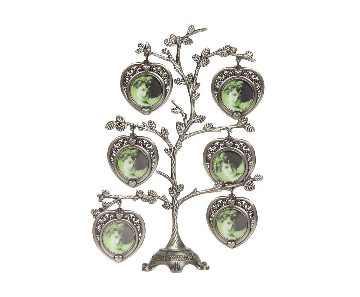 Фоторамка HomeMaster Фамильное дерево, цвет: серебристый, 16 х 7 х 25 смUP210DFНастольная фоторамка Семейное дерево, выполненная из металла с серебряно-никелевым покрытием, позволит вам украсить помещение оригинальным образом. Композиция представляет собой ствол дерева, на ветках которого расположены небольшие кольца для подвешивания небольших овальных фоторамок разного размера (входят в комплект). Декоративная композиция позволит сохранить на память изображения дорогих вам людей и интересных событий вашей жизни. для 6 фотографий 4 х 4 см.