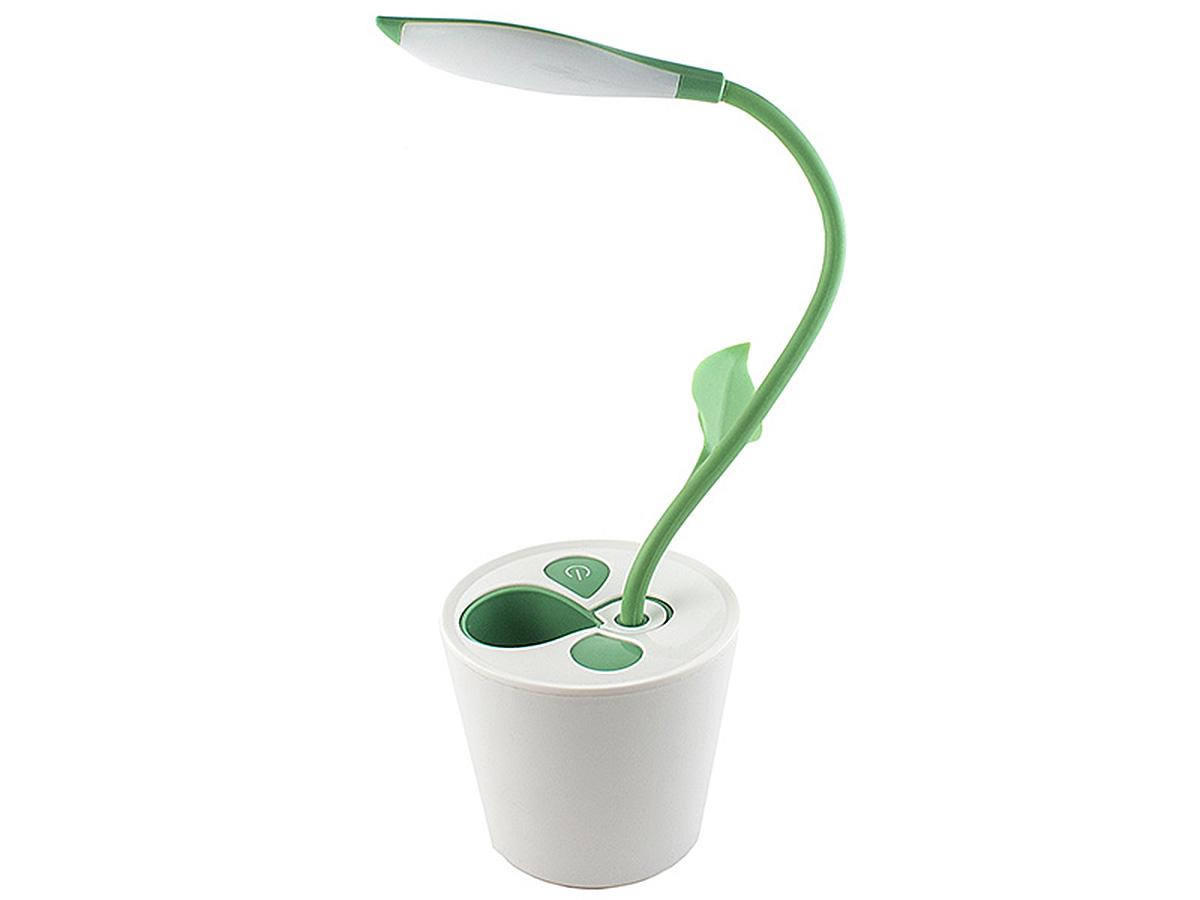 Светилник настольный Эврика Саженец54 366027Светильник на гибкой ножке удачно имитирует горшечное растение. В углу верхнего листика расположена светодиодная лампа, помогающая работать за столом в тёмное время суток. Гнущийся стебель-ножка позволяет настроить освещение под нужным углом. В основании горшка находится емкость, которую можно использовать для хранения ручек, карандашей и других канцелярских мелочей Светильник имеет возможность подключения к USB-порту вашего компьютера. Материал: пластик, силикон.Упаковка: картонная коробка.
