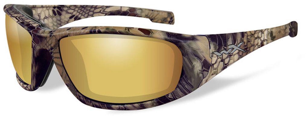 Очки солнцезащитные WileyX Boss Polarized, для охоты, рыбалки и активного отдыха, цвет: Gold Mirror, Amber (Kryptek Highlander)162Поляризованные зеркальные янтарно-золотистые линзы обеспечивают превосходную видимость, как при ярком, так и в слабом освещении, и они идеально подходят для активного отдыха, особенно для рыбалки. Линзы Wiley X, изготовленые из безосколочного поликарбоната с устойчивостью к царапинам, обеспечивают 100% УФ-защиту.ПОЛЯРИЗАЦИОННЫЙ ФИЛЬТР 8ТМ Запатентованная WileyX технология поляризации линз обеспечивает 100% поляризацию и 100% защиту от ультрафиолетовых лучей для непревзойденной четкости и контрастности изображения.НАКЛАДКИ FACIAL CAVITY™ SEALS Запатентованные защитные накладки FACIAL Cavity™ защищают от ветра, механических обломков и периферийного освещения. ЗАЩИТА ОТ УДАРОВ НА ВЫСОКОЙ СКОРОСТИ Оправа и линзы должны выдерживать удар тяжелого снаряда весом 500 гр, падающего с высоты 127 смПРОЧНОЕ ПОКРЫТИЕ Устойчивое к царапинам покрытие защищает линзы от механических повреждений и продлевает срок их службы.АНТИБЛИКОВОЕ ПОКРЫТИЕ Антибликовое покрытие устраняет нежелательные отражения с поверхностей линз. ВОДООТТАЛКИВАЮЩЕЕ ПОКРЫТИЕ Водоотталкивающее покрытие обеспечивает скатывание воды с поверхности линз. Используется только на поляризационных линзах.