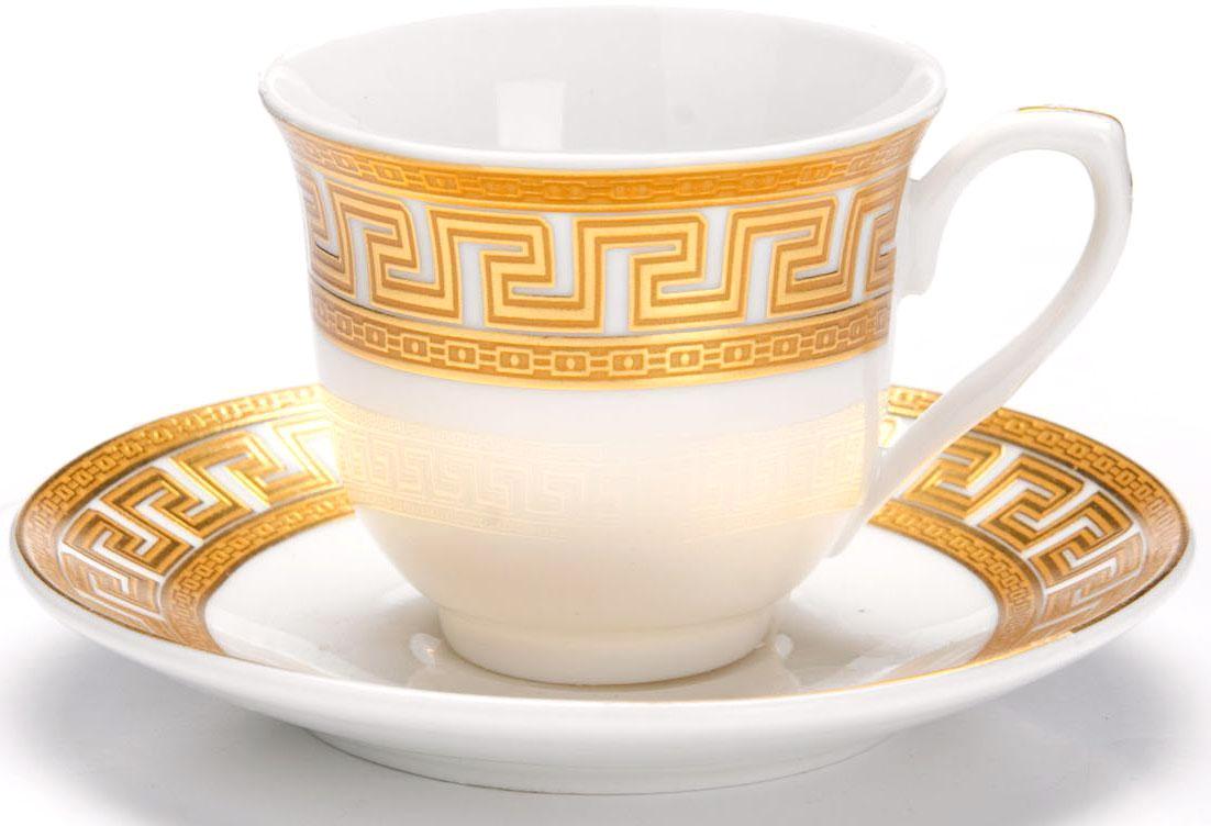 Кофейный сервиз Loraine, 80 мл, подарочная упаковка. 26447115510Кофейный сервиз Loraine на 6 персон выполнен из высококачественной керамики белого цвета и украшен широким золотым орнаментом в греческом стиле. Изящный дизайн придется по вкусу и ценителям классики, и тем, кто предпочитает утонченность и изысканность. Набор упакован в подарочную коробку. Каждый предмет надежно зафиксирован внутри коробки благодаря специальным выемкам. Кофейный набор - идеальный и необходимый подарок для вашего дома и для ваших друзей в праздники, юбилеи и торжества! Также он станет отличным корпоративным подарком и украшением любой кухни. В наборе: 6 кофейных чашек, 6 блюдец.
