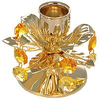 Подсвечник Цветок. 6751767517Декоративное изделие в виде распустившегося цветка украшено кристаллами Swarovski. Миниатюра изготовлена из высококачественной стали. Оригинальный сувенир будет отличным подарком для ваших друзей и коллег. Более 30 лет компания Crystocraft создает качественные, красивые и изящные сувениры, декорированные различными кристаллами Swarovski. Характеристики: Материал: металл, австрийские кристаллы. Диаметр подставки (нижней части подсвечника): 6 см. Высота подсвечника: 6,5 см. Диаметр подставки для свечи: 2,5 см. Производитель: Китай. Артикул: 67517.