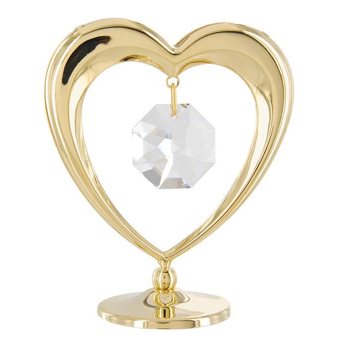 Миниатюра Сердечко, цвет: золотистый, 7 см67105Миниатюра Сердечко, золотистого цвета, станет необычным аксессуаром для Вашего интерьера и создаст незабываемую атмосферу. Кристаллы, украшающие сувенир, носят громкое имя Swarovski - ограненные, как бриллианты, кристаллы блистают сотнями тысяч различных оттенков. Эта очаровательная вещь послужит отличным подарком близкому человеку, родственнику или другу, а также подарит приятные мгновения и окунет Вас в лучшие воспоминания. Характеристики: Материал: металл (углеродистая сталь, покрытие золотом 0,05 микрон), австрийские кристаллы. Размер: 7 см х 6 см х 3 см. Цвет: золотистый. Размер упаковки: 9 см х 7 см х 2 см. Изготовитель: Польша. Артикул: 67105. Более чем 30 лет назад компания Crystocraft выросла из ведущего производителя в перспективную торговую марку, которая задает тенденцию благодаря безупречному чувству красоты и стиля. Компания создает изящные, качественные, яркие сувениры, декорированные кристаллами Swarovski ...
