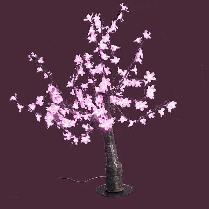 Светодиодное дерево Сакура, цвет: розовыйKT415EСакура - это не просто дерево. Это дерево - символ удачи, любви, красоты и юности. Светодиодное дерево Сакура представляет собой имитацию цветущей японской сакуры. Оно используется для декоративного освещения интерьеров и ландшафтов. Такое дерево с нежно-розовыми огоньками может стать прекрасным украшением для вашего дома, офиса, торгового зала, кафе ресторана или загородного участка. Оно создаст уют, придаст оригинальный стиль и необходимый вам колорит независимо от времени года.Конструкция имеет лекгосплавной каркас в оболочке из темного пластика. На ветках дерева расположены яркие светодиодные гирлянды с силиконовыми насадками (цветками). Светодиодное дерево выглядит очень натурально. Питание осуществляется через сетевой трансформатор, поэтому изделие является низковольтным и может использоваться в уличных условиях. Характеристики: Материал:пластик, силикон, металл. Высота:80 см. Диаметр основания:19 см. Количество веток:16 шт. Цвет свечения:розовый. Количество ламп:160 шт. Напряжение питания:24 V. Мощность:15 Вт. Влагозащита:IP-64. Вес:6,5 кг. Размер упаковки:30 см х 61 см х 27 см. Производитель: Китай. Артикул: LED-T-P.