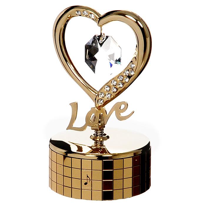 Миниатюра Сердце, цвет: золотистый, музыкальнаяU0252-081-GC1Миниатюра Сердце на музыкальной подставке, золотистого цвета, станет необычным аксессуаром для вашего интерьера и создаст незабываемую атмосферу. Кристаллы, украшающие сувенир, носят громкое имя Swarovski. Ограненные, как бриллианты, кристаллы блистают сотнями тысяч различных оттенков. Эта очаровательная вещь послужит отличным подарком близкому человеку, родственнику или другу, а также подарит приятные мгновения и окунет Вас в лучшие воспоминания. Характеристики: Материал: металл, австрийские кристаллы. Размер миниатюры: 5 см х 9 см х 5 см. Цвет: золотистый. Размер упаковки: 7 см х 9 см х 4,5 см. Изготовитель: Китай. Артикул: U0252-081-GC1. Более чем 30 лет назад компания Crystocraft выросла из ведущего производителя в перспективную торговую марку, которая задает тенденцию благодаря безупречному чувству красоты и стиля. Компания создает изящные, качественные, яркие сувениры, декорированные кристаллами Swarovski различных...