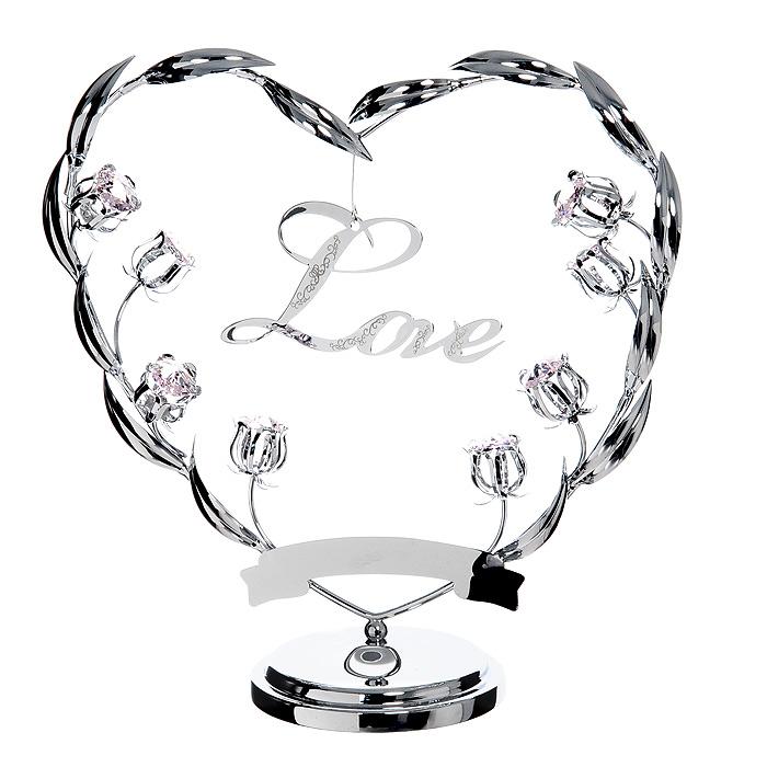 Миниатюра Любовь, цвет: серебристыйU0388-173-CPIOМиниатюра Любовь, серебристого цвета, станет необычным аксессуаром для вашего интерьера и создаст незабываемую атмосферу. Кристаллы, украшающие сувенир, носят громкое имя Swarovski - ограненные, как бриллианты, кристаллы блистают сотнями тысяч различных оттенков. Эта очаровательная вещь послужит отличным подарком близкому человеку, родственнику или другу, а также подарит приятные мгновения и окунет Вас в лучшие воспоминания. Характеристики: Материал: металл, австрийские кристаллы. Размер миниатюры: 20 см х 20 см х 8 см. Цвет: серебристый. Размер упаковки: 24,5 см х 10 см х 24,5 см. Изготовитель: Китай. Артикул: U0388-173-CPIO. Более чем 30 лет назад компания Crystocraft выросла из ведущего производителя в перспективную торговую марку, которая задает тенденцию благодаря безупречному чувству красоты и стиля. Компания создает изящные, качественные, яркие сувениры, декорированные кристаллами Swarovski различных размеров и оттенков,...