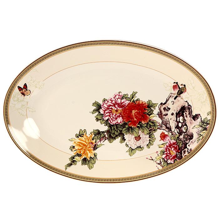 Блюдо Японский сад, 38 х 26 смVT-1520(SR)Блюдо Японский сад овальной формы прекрасно подойдет для красивой сервировки стола. Оно изготовленное из высококачественной керамики кремового цвета и декорировано красочным цветочным рисунком.Изящный дизайн придется по вкусу и ценителям классики, и тем, кто предпочитает утонченность и изысканность. Характеристики:Материал: керамика. Размер блюда: 38 см х 26 см. Размер упаковки: 39 см х 27 см х 5 см. Производитель:Китай. Артикул: IMC1185-1730AL. Изделия торговой марки Imari произведены из высококачественной керамики, основным ингредиентом которой является твердый доломит, поэтому все керамические изделия Imari - легкие, белоснежные, прочные и устойчивы к высоким температурам. Высокое качество изделий достигается не только благодаря использованию особого сырья и новейших технологий и оборудования при изготовлении посуды, но также благодаря строгому контролю на всех этапах производственного процесса. Нанесение сверкающей глазури, не содержащей свинца, придает изделиям Imari превосходный блеск и особую прочность.Красочные и нежные современные декоры Imari - это результат профессиональной работы дизайнеров, которые ежегодно обновляют ассортимент и предлагают покупателям десятки новый декоров. Свою популярность торговая марка Imari завоевала благодаря высокому качеству изделий, стильным современным дизайнам, широчайшему ассортименту продукции, прекрасным подарочным упаковкам и низким ценам. Все эти качества изделий сделали их безусловным лидером на рынке керамической посуды.