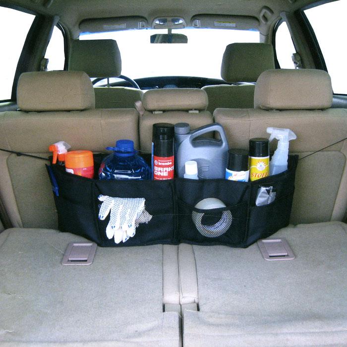 Органайзер автомобильный Comfort Adress, цвет: черныйCA-3505Классический автомобильный органайзер Comfort Adress устанавливается в самый дальний нижний угол багажника. Органайзер выполнен из непромокаемой ткани, которая защитит вещи от влаги и грязи. При небольших размерах, он вмещает в себя все, что необходимо в дороге. К низу пришиты липучки, которые держат его на месте. Характеристики: Материал: непромокаемая ткань ПВХ 600D. Размер (Д х Ш х В): 76 см х 15 см х 25 см. Цвет: черный. Производитель: Россия. Артикул: bag 025.