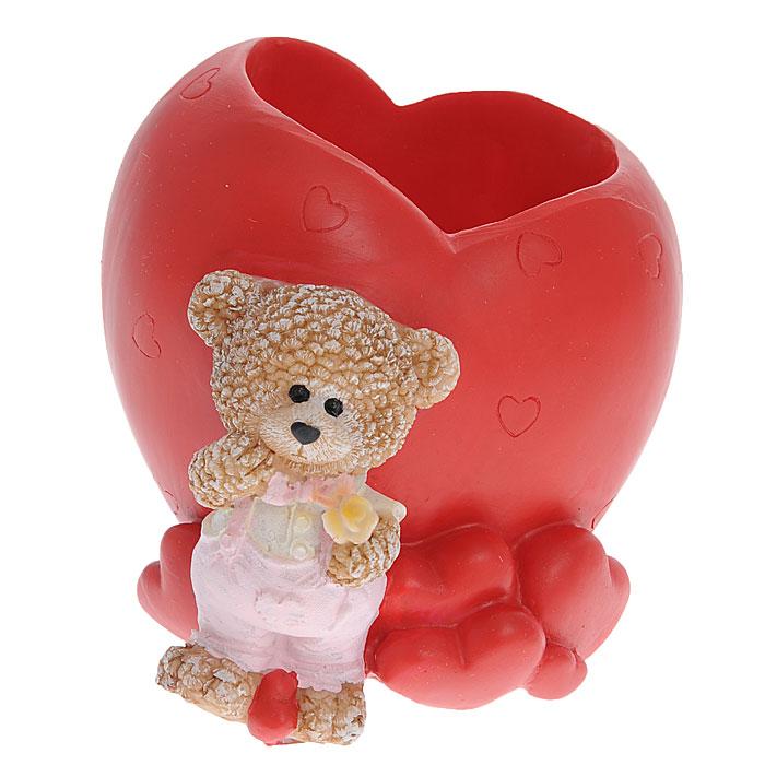 Карандашница Сердце. 2871928719Карандашница выполнена из полирезины в форме сердца и декорирована фигуркой очаровательного медвежонка. Карандашница поможет навести порядок на вашем рабочем столе и станет великолепным сувениром ко дню влюбленных. Характеристики: Материал: полирезина. Размер карандашницы: 9 см х 8 см х 8,5 см. Размер упаковки: 12 см х 10,5 см х 10,5 см. Артикул: 28719.