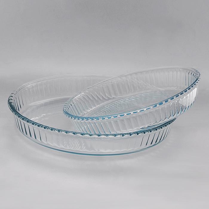 Набор форм для запекания BorCam для СВЧ, 2 шт159022Набор Borcam состоящий из двух круглых форм для СВЧ, изготовленных из термостойкого стекла, будет отличным выбором для всех любителей блюд, приготовленных в духовке, микроволновой печи. Форма не вступает в реакцию с готовящейся пищей, а потому не выделяет никаких вредных веществ, не подвергается воздействию кислот и солей. Из-за невысокой теплопроводности пища в стеклянной посуде гораздо медленнее остывает. Стеклянная посуда очень удобна для приготовления и подачи самых разнообразных блюд: супов, вторых блюд, десертов. Благодаря прозрачности стекла, за едой можно наблюдать при ее готовке, еду можно видеть при подаче, хранении. Используя эту форму, вы можете как приготовить пищу, так и изящно подать ее к столу, не меняя посуды. Форма может быть использована в духовках, микроволновых печах и морозильных камерах (выдерживает температуру от - 30°C до 300°C). Можно мыть и сушить в посудомоечной машине. Характеристики: Материал: стекло. Диаметр формы 2,6...