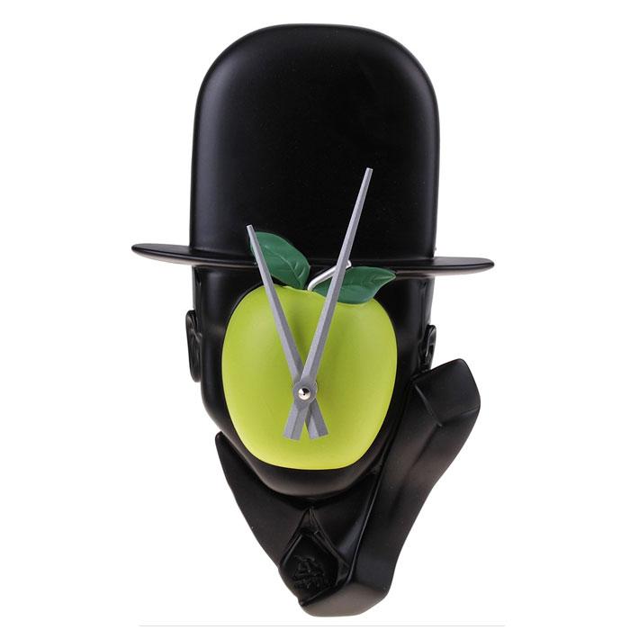 Часы настенные Человек с яблоком. 652512652512Оригинальные настенные часы Человек с яблоком - интерьерный арт-объект, выполненный вручную итальянскими мастерами из экологически чистого материала - мраморной крошки по мотивам картины бельгийского художника-сюрреалиста Рене Магритта Сын Человеческий. Часы оснащены немецким кварцевым механизмом. Человек в шляпе-котелке с закрытым зеленым яблоком лицом - необычное дизайнерское решение и стильное украшение интерьера. Этот аксессуар не только оформит интерьер, но и послужит функционально. Оформите совой дом таким интерьерным шедевром или преподнесите его в качестве презента друзьям, и они оценят ваш оригинальный вкус и неординарность подарка. Характеристики: Материал: мраморная крошка. Размер: 8 см x 19 см x 32 см. Артикул: 652512.
