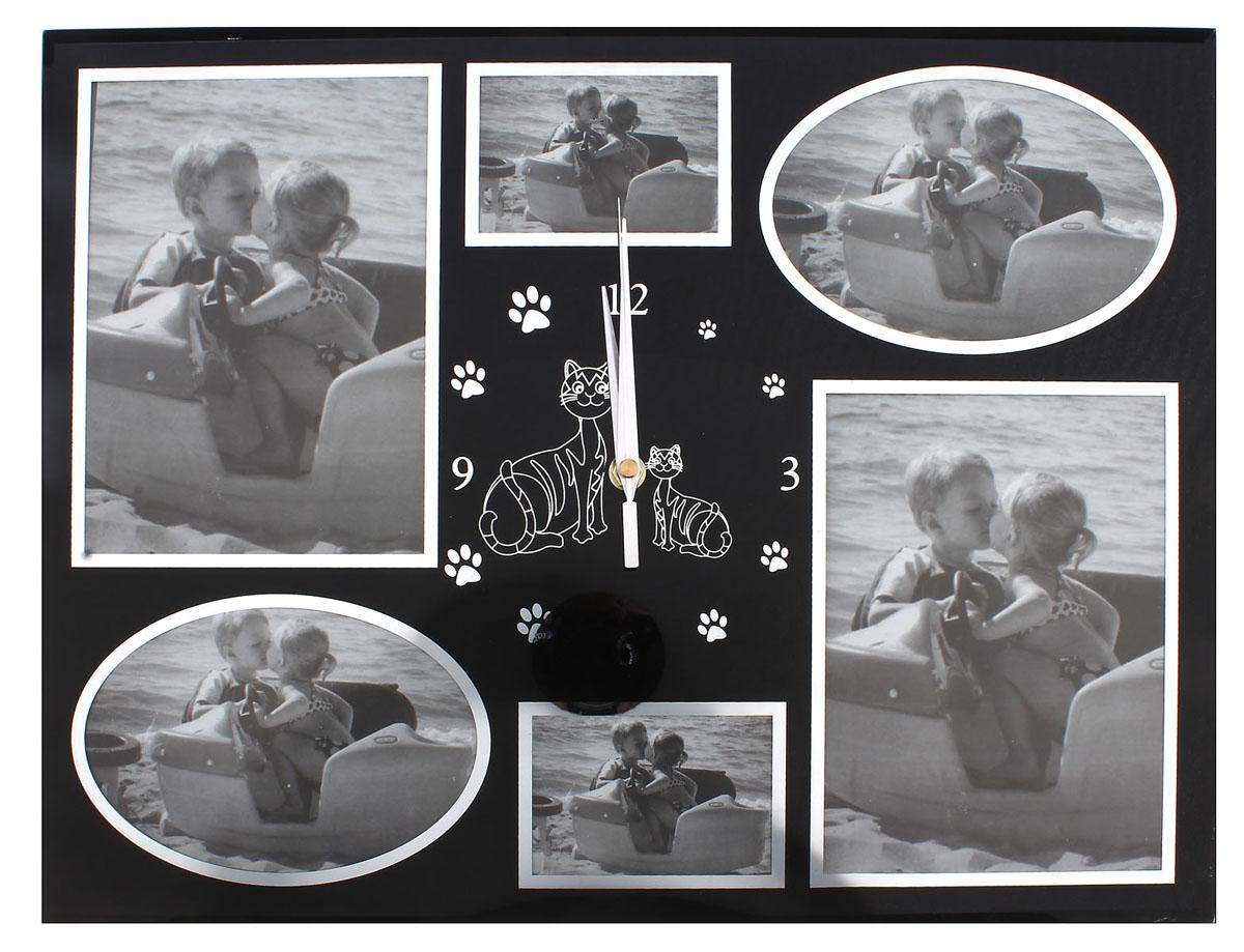 Часы настенные Sima-land, кварцевые, с 6 фоторамками. 487333487333Настенные кварцевые часы Sima-land - это прекрасный предмет декора, а также универсальный подарок практически по любому поводу. Корпус часов, выполнен из прочного стекла с черным покрытием, оформлен шестью фоторамками в серебристой окантовке, разного размера и формы. Посередине расположен циферблат оснащенный тремя стрелками: часовой, минутной и секундной. Цифры и метки в виде кошачьих лапок нанесены серебристой краской сверху. Так же посередине часы декорированы изображением кошек. На задней стенке часов расположена металлическая петелька для подвешивания и блок с часовым механизмом. Часы с рамками прекрасно впишутся в любой интерьер. В зависимости оттого, что вы поместите в рамки, будет меняться и стиль часов. Характеристики: Материал: стекло, металл. Тип механизма: плавающий, бесшумный. Размер часов: 45 см х 34 см х 2 см. Толщина корпуса часов: 2 см. Диаметр циферблата: 13 см. Размер фото: 14,5 см х 10 см; 13 см х 18 см, 9 см х 6...