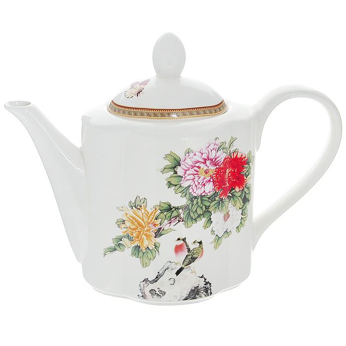 Чайник заварочный Японский сад, 1 лIM15018AB-1730ALЧайник Японский сад, выполненный из высококачественной керамики и оформленный нежным цветочным рисунком, станет незаменимым помощником на кухне. Он сочетает в себе изысканный дизайн с максимальной функциональностью. Такой чайник станет незаменимым атрибутом чаепития и послужит не только приятным подарком, но и практичным сувениром. Размер чайника (без учета крышки) (Д х Ш х В): 24 х 10 х 13 см.