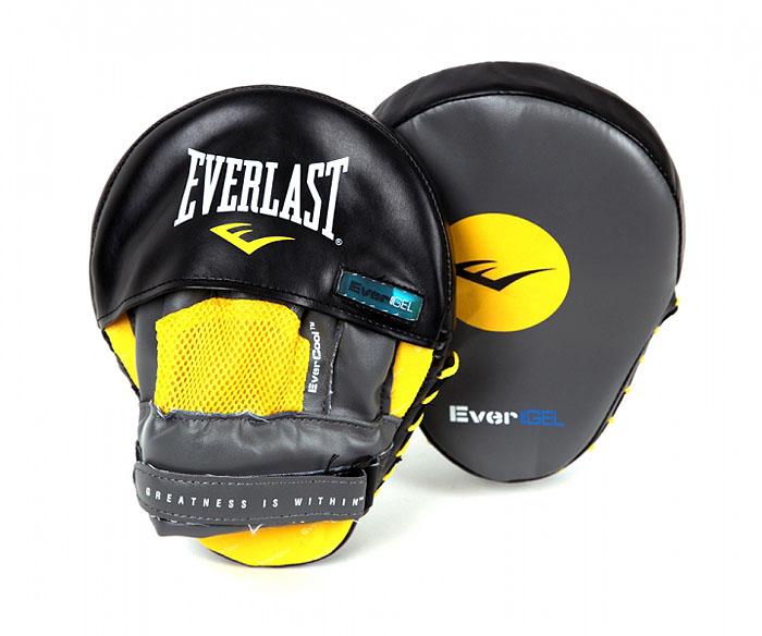 Лапы боксерские Everlast Evergel Mantis, изогнутые, цвет: серый, желтый, черныйadiB220Профессиональные боксерские лапы Everlast Evergel Mantis предназначены для занятий боксом и единоборствами. Лапы выполнены из мягкой натуральной кожи. Высококачественный пенный наполнитель тренерских лап превосходно держит удар и защищает кисти рук тренера при подготовке подопечного к бою. Форма наручного снаряда и удобное крепление, надежно поддерживающее запястье, позволяет выдержать удары спортсменов. Фиксатор в виде перчатки, надежно удерживает запястье, уберегая суставы рук от травм. Характеристики:Материал: кожа, текстиль, пена. Размер лапы: 18 см х 24 см х 13 см. Толщина наполнителя: 5 см. Изготовитель: Китай. Артикул: 410001GLU.