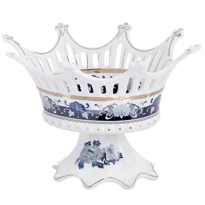 Конфетница Синий павлин, 20 х 16 см545-658Изящная конфетница Синий павлин, изготовленная из высококачественного фарфора белого цвета, непременно понравится любителям классического стиля. Стенки конфетницы декорированы перфорацией, дно оформлено изображением синих павлинов. Конфетница Синий павлин оригинально украсит ваш стол и подчеркнет изысканный вкус хозяйки. Характеристики: Материал: фарфор. Размер конфетницы: 20 см х 16 см х 13 см. Размер упаковки: 20 см х 16 см х 14 см. Артикул: 545-658.
