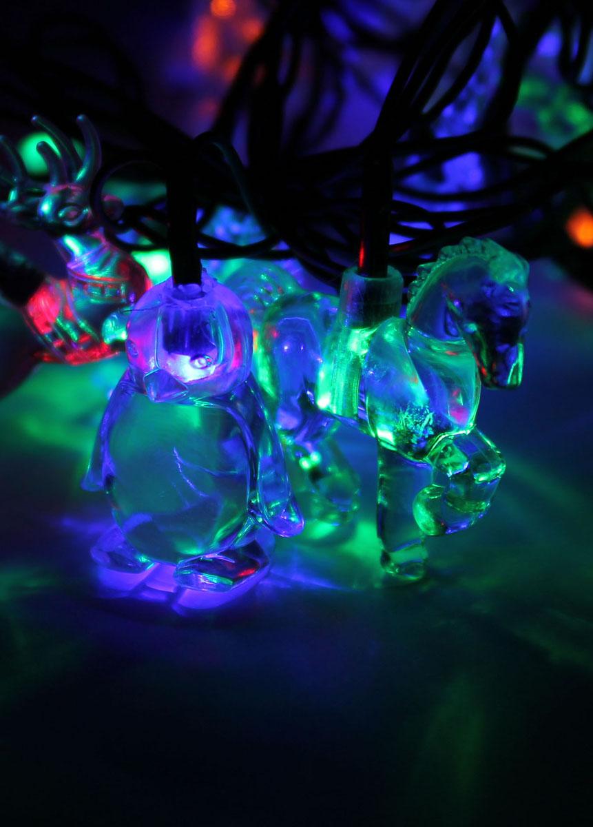 Светодиодная гирлянда Космос Животные, 30 светодиодов, 4,4 мKOC_GIR30LEDMIX3_RGBДекоративная гирлянда с прозрачными насадками в виде животных отлично подойдет для украшения елки. Имеет 8 режимов мигания. Характеристики: Материал: пластик. Цвет: мульти. Размер лошади: 5,5 см х 4,5 см. Размер оленя: 5,5 см х 4 см. Размер пингвина: 4 см х 3,5 см. Количество светодиодов: 30 шт. Питание: от сети 230 В. Размер упаковки: 18 см х 8 см х 10 см.