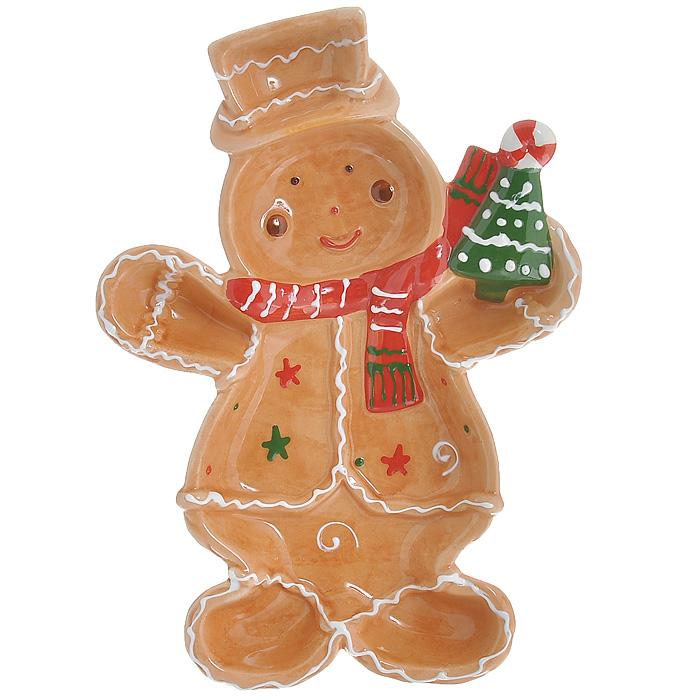 Блюдо Снеговик, 26 см х 18 см х 3 смYM121248-2B/CБлюдо Снеговик выполнено из высококачественного фаянса. Блюдо изготовлено в форме снеговика с елочкой в руке. Данное блюдо сочетает в себе оригинальный дизайн с максимальной функциональностью, оно отлично подойдет для подачи десертов, фруктовых салатов. Красочность оформления особенно подойдет для новогоднего торжества. Характеристики: Материал: фаянс. Цвет: коричневый. Размер блюда (Д х Ш х В): 26 см х 18 см х 3 см. Размеры упаковки: 26 см х 18 см х 4 см. Артикул: YM121248-2B/C.