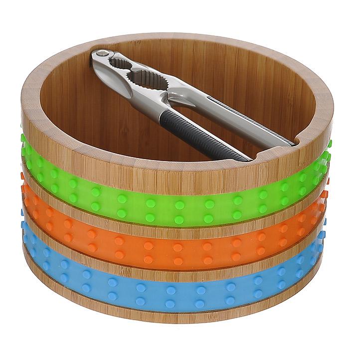 Миска для орехов Frybest, с щипцамиMUR-WBВместительная миска для орехов Frybest выполнена из высококачественной древесины бамбука и декорирована яркими силиконовыми вставками. Бамбуковая миска не впитывает запахи и легко моется. Выполненная из натуральных материалов, она абсолютно экологична и гипоаллергенна. Щипцы изготовлены из качественной стали и имеют пластиковые вставки, которые не позволят инструменту выскользнуть из ваших рук. Они прекрасно подойдут для колки орехов разных размеров. Стенки миски оснащены специальными выемками для удобного расположения щипцов. Яркий и стильный дизайн для украшения вашей кухни! Характеристики: Материал: бамбук, силикон, сталь, пластик. Диаметр миски по верхнему краю: 18 см. Высота стенки миски: 10 см. Длина щипцов: 16 см. Размер упаковки: 18,5 см х 18,5 см х 10,5 см. Артикул: MUR-WB.