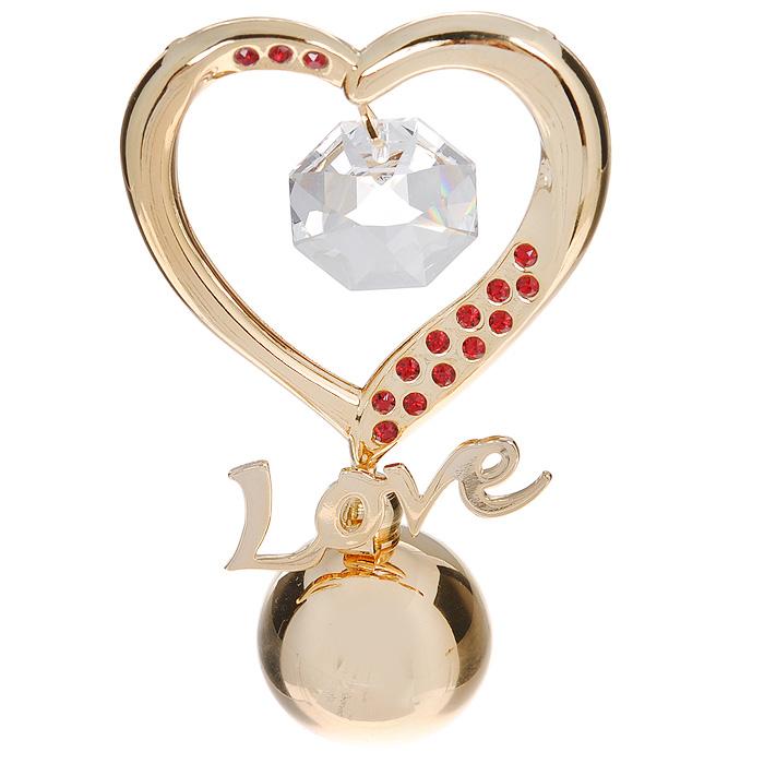 Фигурка декоративная Сердце, цвет: золотистый. 6753867538Декоративная фигурка Сердце выполнена из углеродистой стали, покрытой золотом толщиной 0,05 микрон. Фигурка украшена крупным белым кристаллом и маленькими красными кристаллами Swarovski. Поставьте фигурку на стол в офисе или дома и наслаждайтесь изящными формами и блеском кристаллов. Изысканный и эффектный, этот сувенир покорит своей красотой и изумительным качеством исполнения, а также станет замечательным подарком. Характеристики: Материал: углеродистая сталь, кристаллы Swarovski. Размер фигурки (ДхШхВ): 5 см х 2,5 см х 8,5 см. Цвет: золотистый. Размер упаковки: 6,5 см х 4,5 см х 9 см. Артикул: 67538.