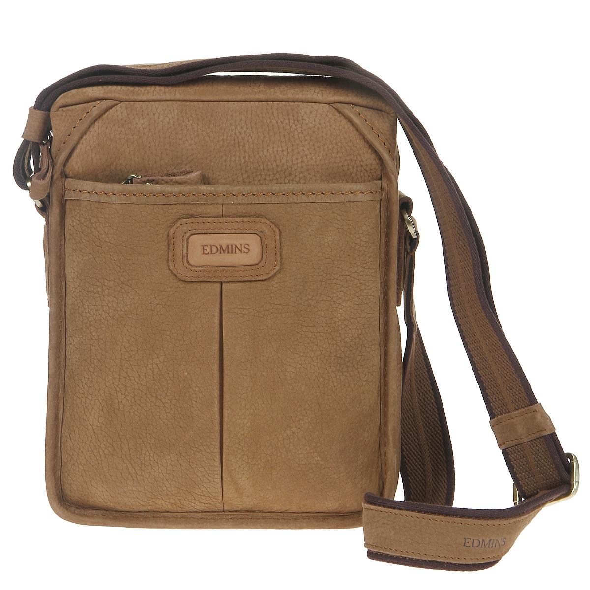 Сумка мужская Edmins, цвет: коричневый. 1045 V-4 SU d.brown1045 V-4 SU d.brownСтильная мужская сумка Edmins изготовлена из итальянской высококачественной натуральной кожи коричневого цвета, что гарантирует безупречный внешний вид и долговечность изделия. Кожа имеет матовую текстуру с естественной лицевой поверхностью. Сумка имеет одно основное отделение, которое закрывается на застежку-молнию. Внутри - два накладных кармашка, два фиксатора для ручки, вшитый карман на молнии и большой открытый карман. С передней стороны расположен дополнительный объемный карман на молнии, с задней стороны - карман на магнитной кнопке. Сумка оснащена плечевым ремнем регулируемой длины. Фурнитура - золотистого цвета. С такой сумкой из деловой линии Edmins вы всегда будете чувствовать себя модно, уверенно и элегантно. Характеристики: Материал: натуральная кожа, текстиль, металл. Цвет: коричневый. Размер сумки (ДхШхВ): 21 см х 8,5 см х 26 см. Длина плечевого ремня: 120 см. Размер упаковки: 33 см х 32 см х 12 см. Артикул: 1045 V-4 SU...