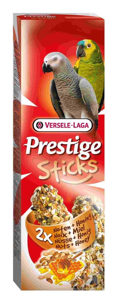 Лакомство для крупных попугаев Versele-Laga Prestige Sticks, с орехами и медом, 2х70 г422315Лакомство Versele-Laga Prestige Sticks - это две запеченные палочки с арахисом, миндалем, медом и другими полезными и вкусными ингредиентами для крупных попугаев. Деревянная палочка оснащена пластиковым крючком, за который лакомство можно повесить на клетку. Благодаря этому ореховому празднику ваша птица насладится кулинарными изысками. Для скуки не останется ни единого шанса. Давайте постоянно как дополнение к основному корму. Состав: семена, зерновые, орехи (2,2%: земляной орех, миндаль), мед (2%), различные сахара, пекарские продукты, масла и жиры. Добавки: консерванты, красители. Комплектация: 2 шт. Вес: 70 г. Товар сертифицирован.