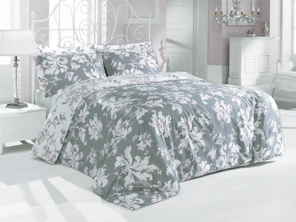 Комплект белья Rosy (1,5 спальный КПБ, сатин, 2 наволочки 50х70), цвет: серо-розовыйRosyКомплект постельного белья Rosy, изготовленный из сатина высокого качества, поможет вам расслабиться и подарит спокойный сон. Комплект состоит из одного пододеяльника, простыни и двух наволочек, оформленных изумительно нежными розовыми цветочными узорами на сером фоне. Белье сшито из сатина - блестящей и плотной ткани, которая изготавливается из крученой хлопковой нити двойного плетения, что придает ей яркость и блеск. Своими свойствами он схож с шелком и кашемиром. Сатин из египетского хлопка отличает от остальных отсутствие линта (хлопкового пуха), поэтому со временем белье не обрастает катышками! Это белье выдерживает более 300 стирок, не теряя своей первоначальной прелести и не тускнея, и его практически не нужно гладить! Благодаря такому комплекту постельного белья вы сможете создать атмосферу роскоши и романтики в вашей спальне. Характеристики: Цвет: серо-розовый. Материал: поверхностная плотность: 200ТС. состав: сатин (100% хлопок). ...