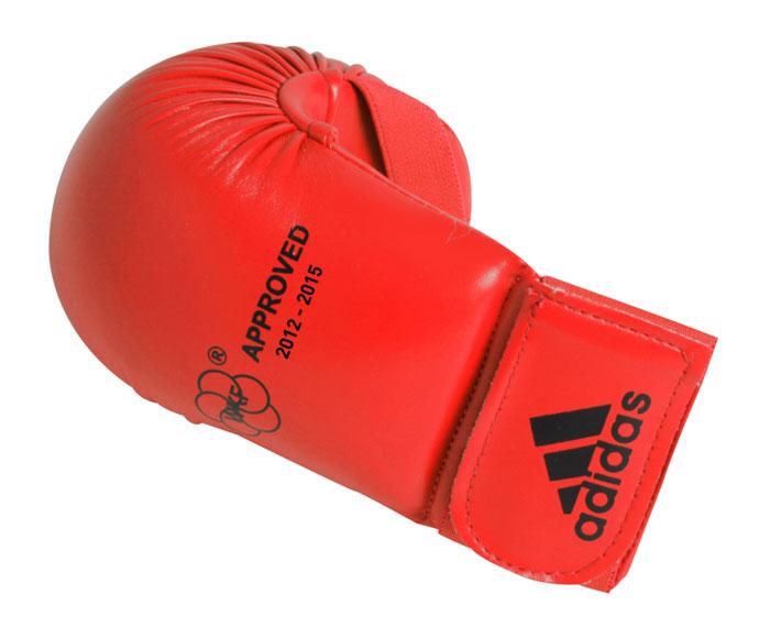 Накладки для карате Adidas WKF Bigger, цвет: красный. 661.22. Размер M661.22Изогнутые накладки Adidas WKF Bigger с объемным наполнителем необходимы при занятиях спортом для защиты пальцев, суставов и кисти руки в целом от вывихов, ушибов и прочих повреждений. Накладки выполнены из высококачественного полиуретан PU3G. Накладки прочно фиксируются на запястье за счет широкой эластичной ленты на липучке. Удобные и эргономичные накладки Adidas идеально подойдут для занятий карате и другими видами единоборств. Одобрены WKF. Рассчитаны на рост 160-170 см.