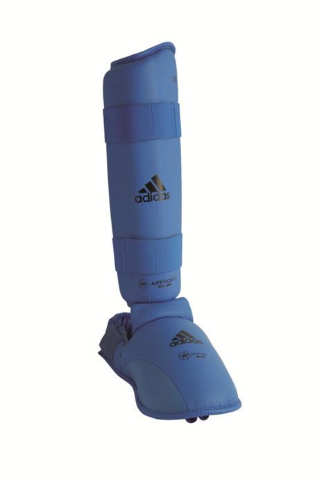 Защита голени и стопы Adidas WKF Shin & Removable Foot, цвет: синий. 661.35. Размер XLAIRWHEEL Q3-340WH-BLACKЗащита голени и стопы Adidas WKF Shin & Removable Foot с объемным наполнителем необходима при занятиях спортом для защиты пальцев, суставов вывихов, ушибов и прочих повреждений. Накладки выполнены из высококачественного полиуретана PU3G. Накладки прочно фиксируются за счет эластичной ленты и липучки. Между собой защита голени и защита стопытакже скрепляются липучкой. Удобные и эргономичные накладки Adidas идеально подойдут для занятий карате и другими видами единоборств.Одобрены WKF.Размер ноги 45-47. Длина защиты голени 37 см.