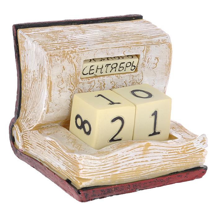 Декоративный календарь Книга. 3336233362 Календарь декоративный арт.33362 из полирезины (10,8*9*9 см) арт.33362Декоративный календарь Книга, выполненный из полирезины в виде книги. Дата на календаре устанавливается вручную с помощью кубиков, на которых указаны числа и месяцы. Кубики вложены в специальные отверстия в календаре и легко вынимаются. Настольный прибор послужит отличным и оригинальным украшением стола. Характеристики: Материал: полирезина. Цвет: бордовый, бежевый. Размер: 10 см х 11 см х 10,5 см.