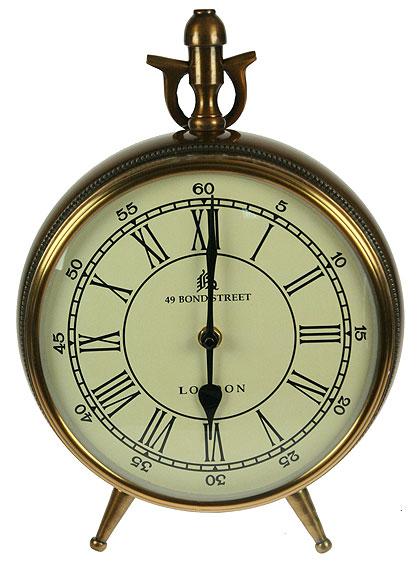 Часы настольные Win Max, цвет: бронзовый, 22 см х 9 см х 21 см35821Настольные часы Win Max имеют круглый корпус, выполненный из металла. Изделие имеет удобную ручку, за которую его можно переносить. Часы имеют две ножки и опору. Оснащены часы высококачественным кварцевым механизмом. Качественные сырье и тонкая обработка, позволяют создавать изделия представительского класса. Настольные часы Win Max - прекрасный подарок и красивый предмет для декора интерьера. Батарейка в комплект не входит. Размер: 22 см х 9 см. Высота (с учетом ручки и ножек): 35 см. Высота (без учета ручки и ножек): 21 см.