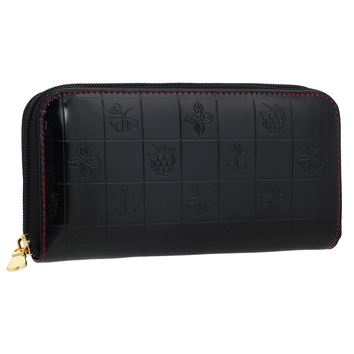 Портмоне женское Dimanche Bonbon, цвет: черный. 540540Стильное женское портмоне Bonbon выполнено из высококачественной натуральной лаковой кожи с декоративным тиснением. Портмоне закрывается на застежку-молнию. Внутри - четыре отделения для купюр, шесть кармашков для визиток, карман на молнии для монет, и горизонтальный карман для чеков и бумаг. Портмоне упаковано в фирменную картонную коробку.